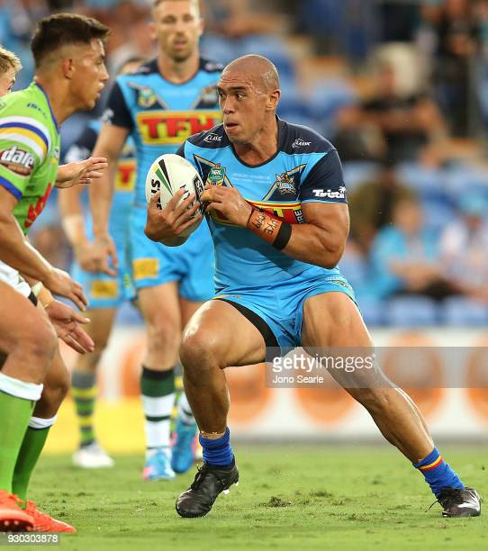 Leilani Latu of the Titans takes a tackle during the round one NRL match between the Gold Coast Titans and the Canberra Raiders at Cbus Super Stadium...