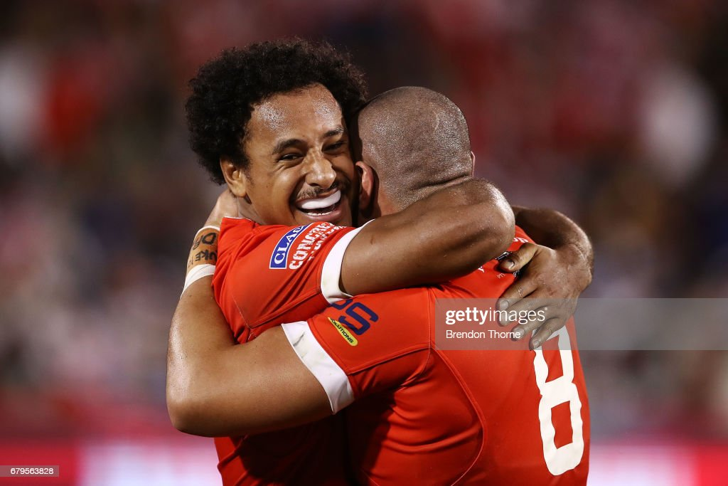 Leilani Latu of Tonga celebrates with team mate Felise Kaufusi at full time after scoring the match winning try during the 2017 Pacific Test Invitational match between Tonga and Fiji at Campbelltown Sports Stadium on May 6, 2017 in Sydney, Australia.