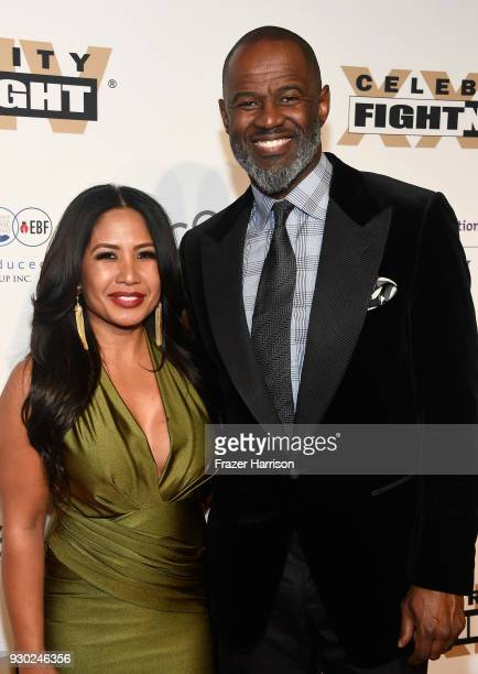 Leilani Mendoza and Brian McKnight attend Celebrity Fight Night XXIV on March 10 2018 in Phoenix Arizona
