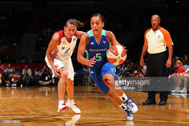 Leilani Mitchell of the New York Liberty drives against Kelly Miller of the Washington Mystics at the Verizon Center on August 6 2011 in Washington...