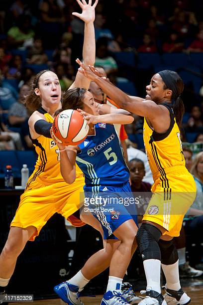 Leilani Mitchell of the New York Liberty gets trapped by Kayla Pedersen and Ivory Latta of the Tulsa Shock during the WNBA game on June 23 2011 at...