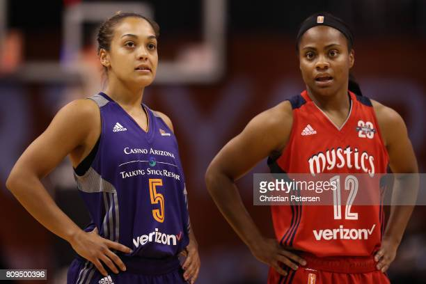 Leilani Mitchell of the Phoenix Mercury and Ivory Latta of the Washington Mystics stand on the court during a break from the second half of the WNBA...