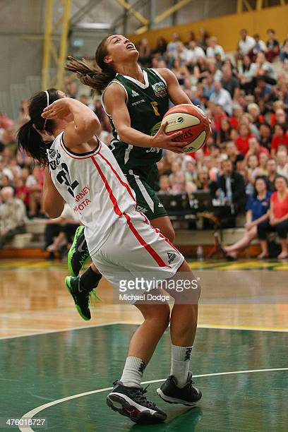 Leilani Mitchell of the Ranges drives to the basket against Micaela Cocks of the Fire during the WNBL Preliminary Final match between the Dandenong...
