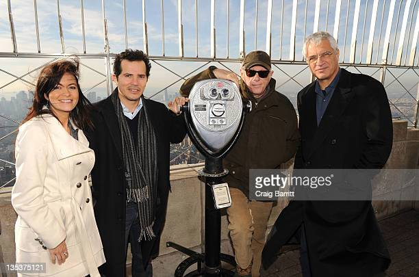 Leilani Munter John Leguizamo Ric O'Barry and Louie Psihoyos light the The Empire State Building to raise awareness for the protection of dolphins in...
