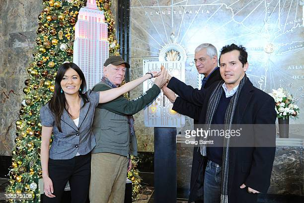Leilani Munter Ric O'Barry Louie Psihoyos and John Leguizamo light the The Empire State Building to raise awareness for the protection of dolphins in...
