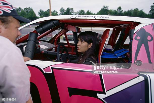 leilani munter talking with pit crew - leilani munter stock pictures, royalty-free photos & images