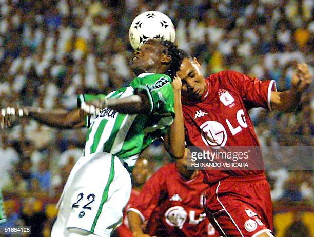 Leiner Orejuela from club Atletico Nacional of Medellin fights for the ball with Jorge Parra from team America of Cali during the final columbian...