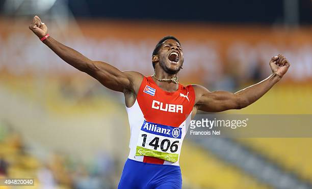 Leinier Savon Pineida of Cuba celebrates winning the men's 200m T12 final during the Evening Session on Day Eight of the IPC Athletics World...