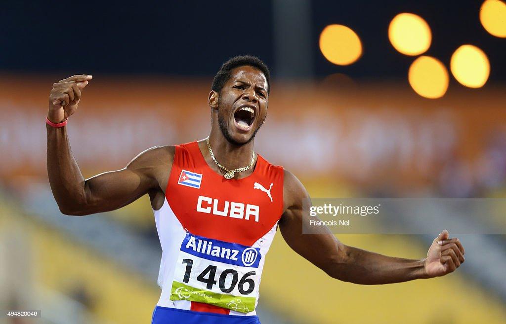 Leinier Savon Pineida of Cuba celebrates winning the men's 200m T12 final during the Evening Session on Day Eight of the IPC Athletics World Championships at Suhaim Bin Hamad Stadium on October 29, 2015 in Doha, Qatar.