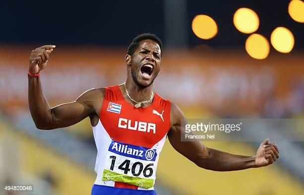 Leinier Savon Pineida of Cuba celebrates winning the men's 200m T12 final during the Evening Session on Day Eight of the IPC Athletics World...