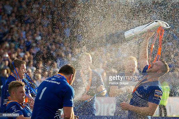 Leinster captain Jamie Heaslip lifts the RaboDirect Pro 12 trophy after victory against Glasgow during the RaboDirect Pro 12 match between Leinster...