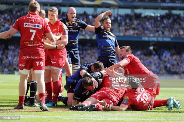 Leinster celebrate as James Ryan dives over for the first try during the European Rugby Champions Cup SemiFinal match between Leinster Rugby and...