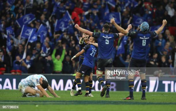 Leinster celebrate as Remi Tales looks dejected after missing with a drop goal which would have taken the match into extra time during the European...