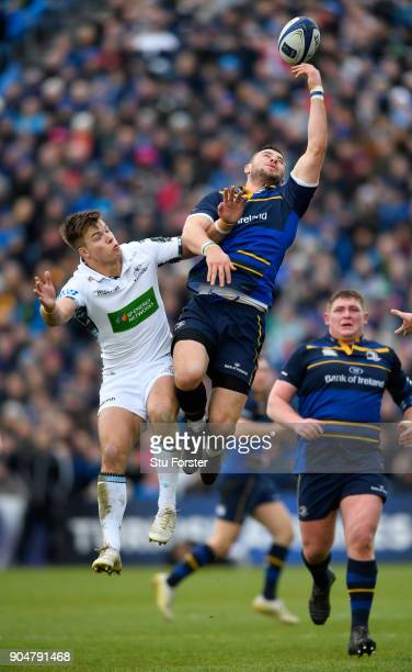 Leinster centre Robbie Henshaw outjumps Huw Jones of Glasgow during the European Rugby Champions Cup match between Leinster Rugby and Glasgow...