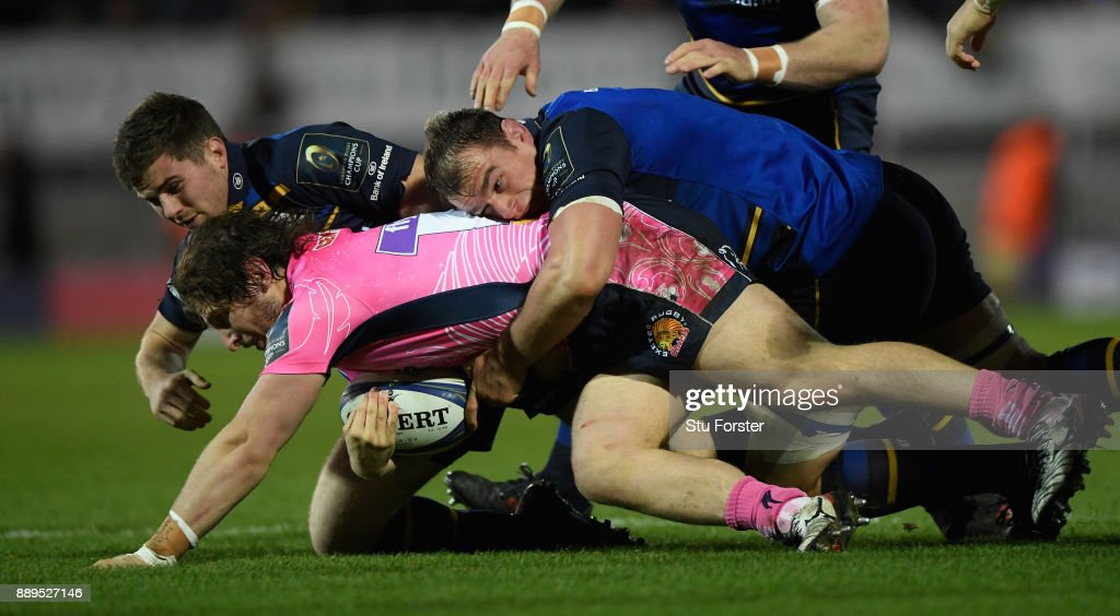 Leinster forward Rhys Ruddock puts in a big tackle on Chiefs prop Alec Hepburn during the European Rugby Champions Cup match between Exeter Chiefs and Leinster Rugby at Sandy Park on December 10, 2017 in Exeter, England.