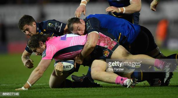 Leinster forward Rhys Ruddock puts in a big tackle on Chiefs prop Alec Hepburn during the European Rugby Champions Cup match between Exeter Chiefs...