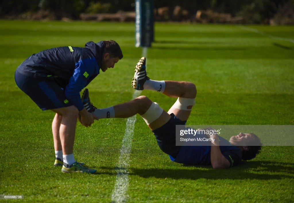 Leinster , Ireland - 20 March 2017; Leinster's Mike McCarthy stretches with the help of Leinster senior rehabilitation coach Diarmuid Brennan during squad training at UCD in Dublin.