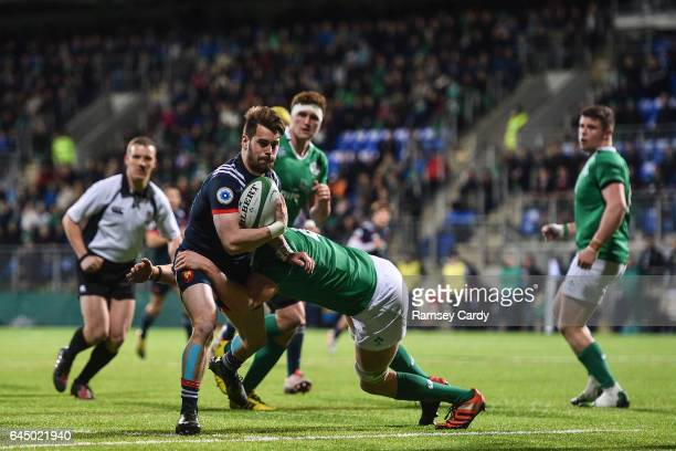 Leinster Ireland 24 February 2017 Arthur Retiere of France is tackled by Jack Regan of Ireland during the RBS U20 Six Nations Rugby Championship...