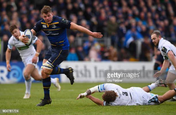 Leinster player Jordi Murphy breaks to score the opening try during the European Rugby Champions Cup match between Leinster Rugby and Glasgow...
