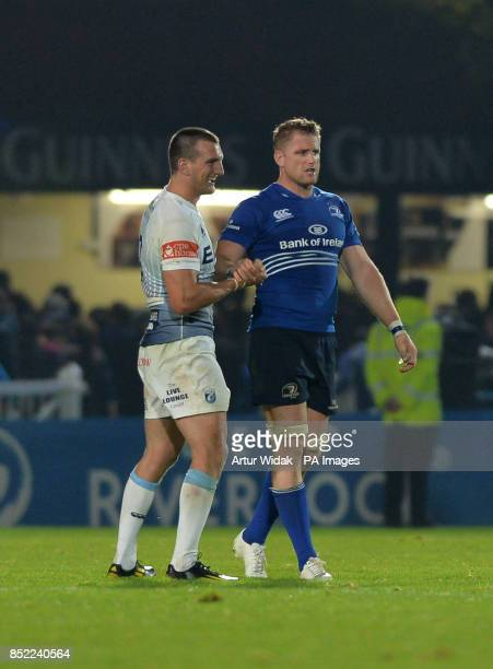 Leinster Rugby Captain Jamie Heaslip is congratulated by Cardiff Blues Sam Warburton during the RaboDirect PRO12 match at the RDS Arena, Dublin,...