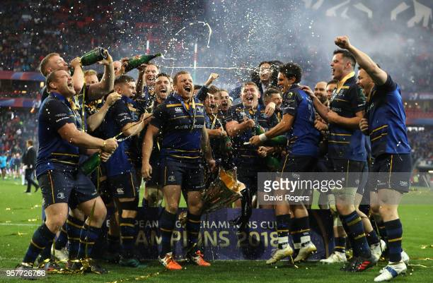 Leinster Rugby players celebrate with the European Rugby Champions Cup Trophy following the European Rugby Champions Cup Final match between Leinster...
