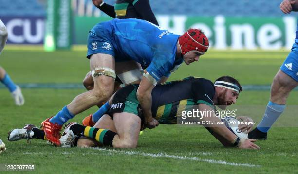 Leinster Rugby's Josh van der Flier tackles Northampton Saints' Tom Wood, during the European Champions Cup match at the RDS Arena, Dublin.