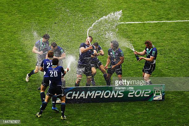 Leinster team spray champagne as they celebrate victory during the Heineken Cup Final between Leinster and Ulster at Twickenham Stadium on May 19,...