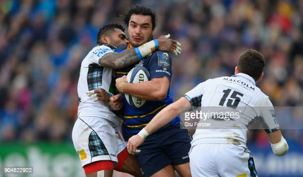 Leinster wing James Lowe is collared by both Isa Nacewa and Ruaridh Jackson during the European Rugby Champions Cup match between Leinster Rugby and...