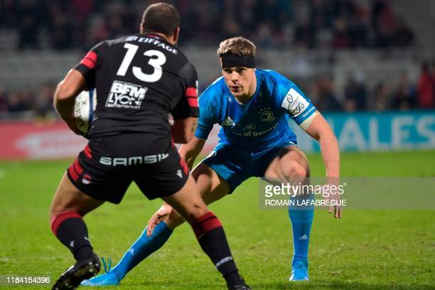 Leinster's Irish center Garry Ringrose vies with Lyon's French center Thibaut Regard during the European Champions Cup rugby union match between Lyon...
