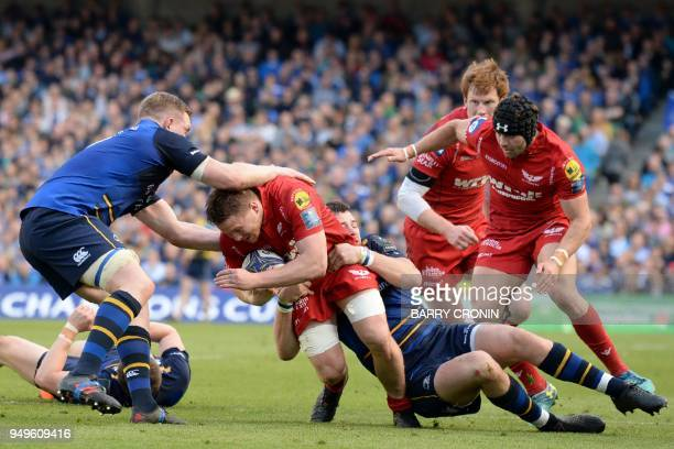 Leinster's Irish centre Robbie Henshaw brings down Leinster's Irish flanker Dan Leavy during the European Champions Cup rugby union semifinal between...