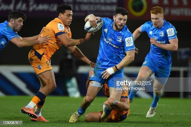 Leinster's Irish centre Robbie Henshaw is tackled by Montpellier's French centre Arthur Vincent during the European Rugby Champions Cup rugby union...