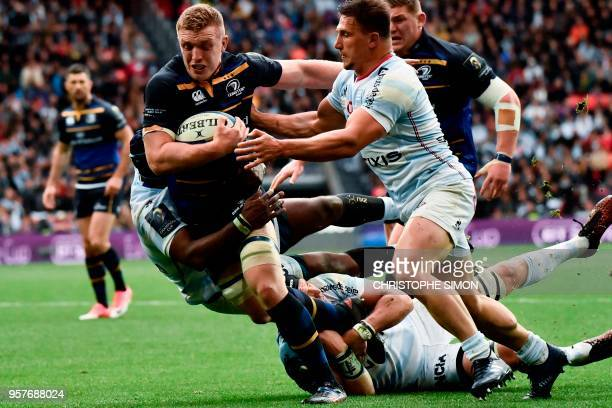Leinster's Irish flanker Dan Leavy tries to escape a tackle during the 2018 European Champions Cup final rugby union match between Racing 92 and...