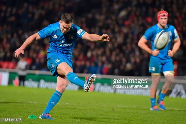 Leinster's Irish fly half Johnny Sexton kicks the ball during the European Champions Cup rugby union match between Lyon and Leinster at the Matmut...
