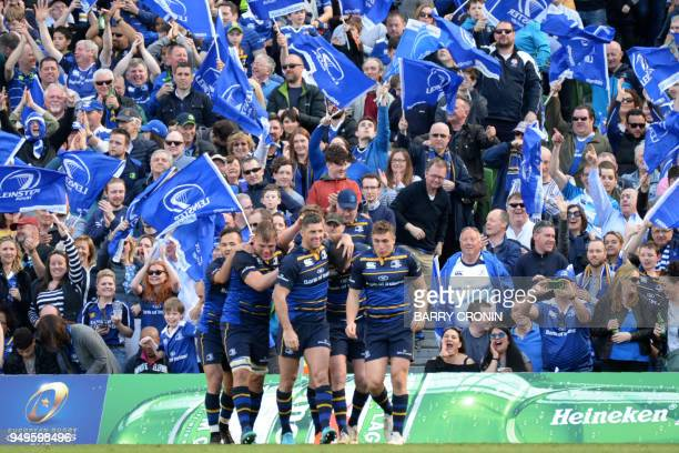 Leinster's Irish flyhalf Johnny Sexton celebrates with teammates scoring a try during the European Champions Cup rugby union semifinal between...