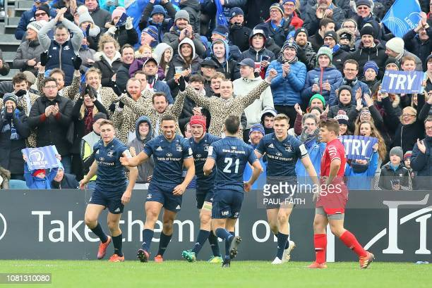 Leinster's Irish wing Adam Byrne celebrates after scoring a try during the European Rugby Champions Cup pool 1 rugby union match between Leinster and...