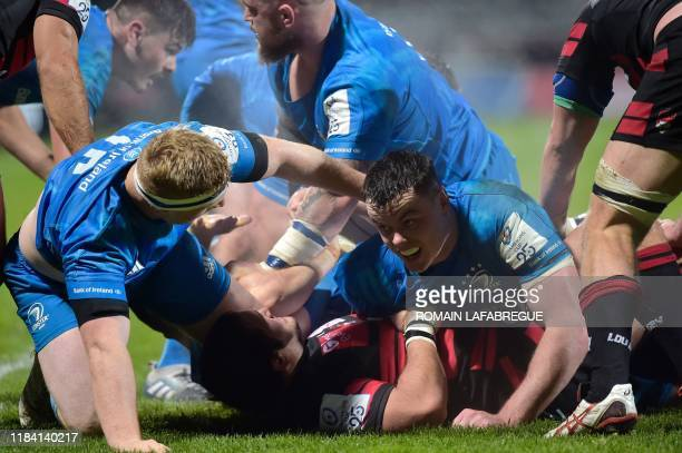 Leinster's Irish wing Jordan Larmour fights for the ball in a scrum during the European Champions Cup rugby union match between Lyon and Leinster at...