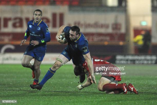 Leinster's Jack Conan is tackled by Scarlets' Jonathan Evans during the Guinness Pro14 Round 17 match between Scarlets and Leinster Rugby at Parc y...