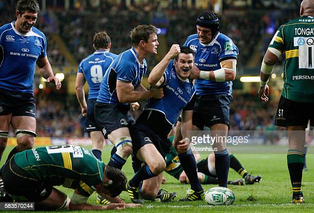 Leinster's Jonny Sexton centre celebrates with team mates after scoring a try during the Heineken Cup Final between Leinster and Northampton at the...