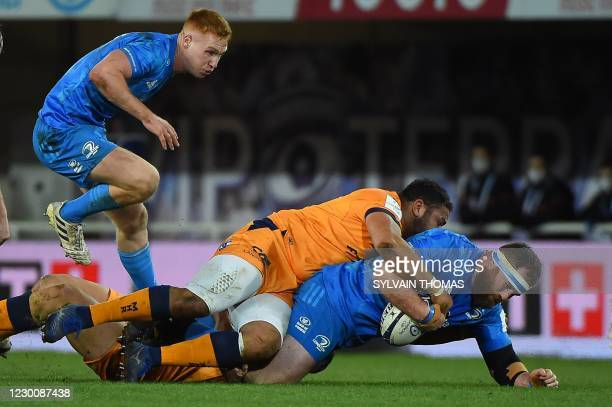 Leinster's Michael Bent is tackled by Montpellier's French prop Mohammed Haouas during the European Rugby Champions Cup rugby union Group A match...