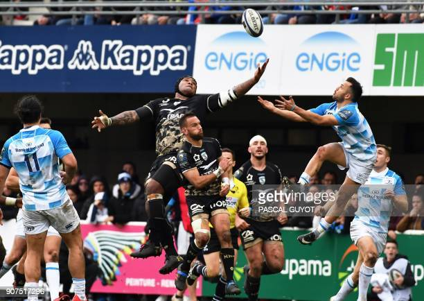 Leinster's New Zealander scrumhalf Jamison GibsonPark vies for the ball with Montpellier's Fijian winger Nemani Nadolo during the European Champions...