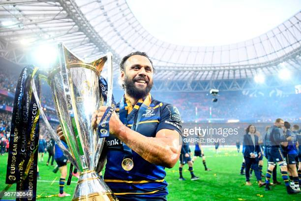 Leinster's New Zealander wing Isa Nacewa celebrates with the trophy after the 2018 European Champions Cup final rugby union match between Racing 92...