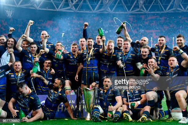 Leinster's players celebrate with the trophy after the 2018 European Champions Cup final rugby union match between Racing 92 and Leinster at the San...