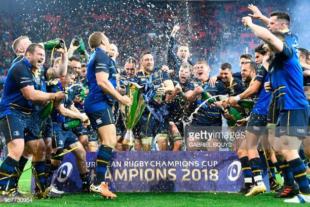 TOPSHOT Leinster's players celebrate with the trophy after the 2018 European Champions Cup final rugby union match between Racing 92 and Leinster at...
