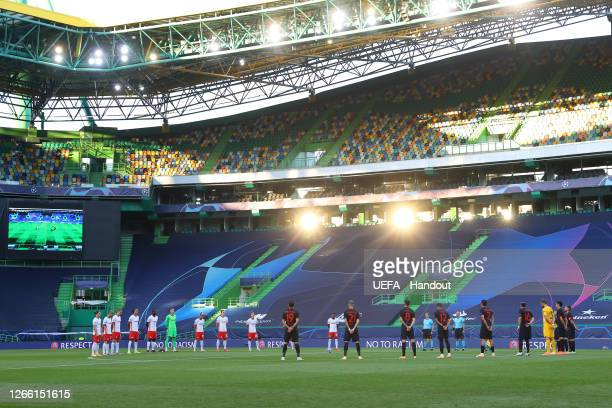 Leipzig and Atletico de Madrid players observe a minutes silence in respect of those who have lost their lives to the COVID-19 Virus prior to the...