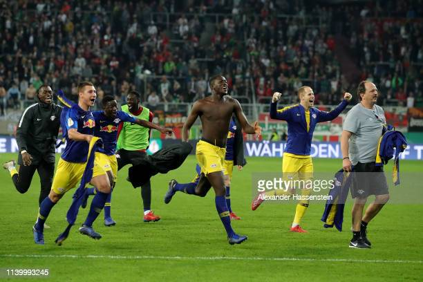 Leipzig celebrate after winning the DFB Cup match between FC Augsburg and RB Leipzig at WWKArena on April 02 2019 in Augsburg Germany
