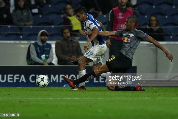 Leipzig defender Bernardo Junior from Brasil tackles FC PortoÕs forward Jesus Corona from Mexico during the match between FC Porto v RB Leipzig or...