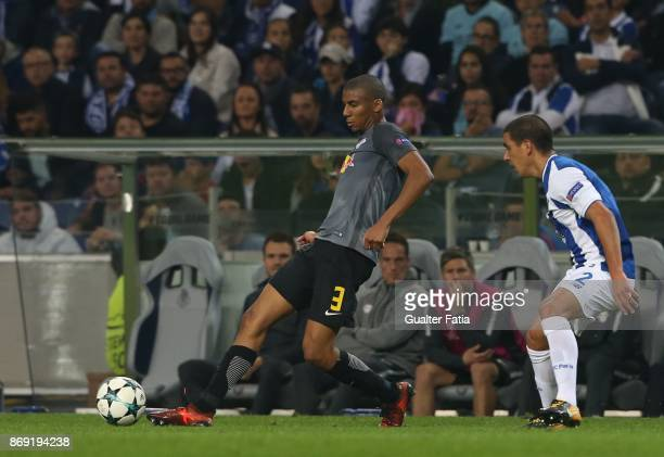 Leipzig defender Bernardo Junior from Brasil with FC Porto defender Maxi Pereira from Uruguay in action during the UEFA Champions League match...