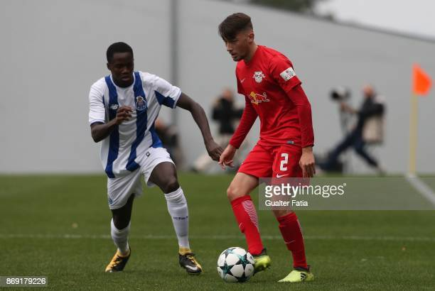 Leipzig defender Mert Yilmaz from Turkey with FC Porto forward Madi Queta in action during the UEFA Youth League match between FC Porto and RB...