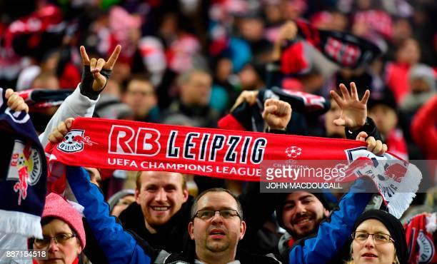 A Leipzig fan holds up a scarf ahead the UEFA Champions League group G football match RB Leipzig vs Besiktas JK in Leipzig eastern Germany on...