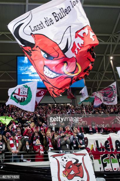 RB Leipzig fans cheer during the German first division Bundesliga football match between RB Leipzig and Schalke 04 in Leipzig eastern Germany on...